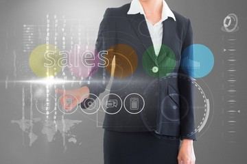 Businesswoman touching the word sales on interface