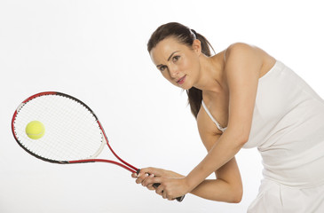 Attractive female tennis player using a two hand grip