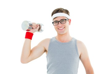 Geeky hipster posing in sportswear with dumbbell