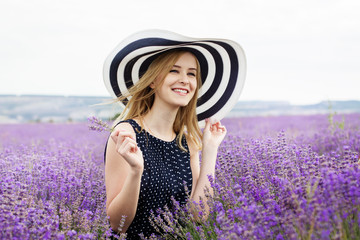 Adorable girl in fairy field of lavender
