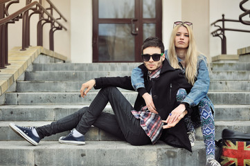 Stylish young couple outdoor portrait