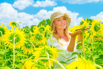 Cute girl in sunflower field
