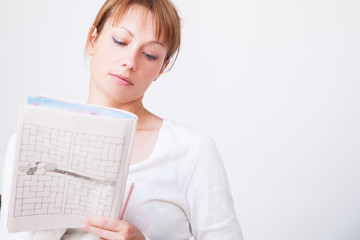 Woman doing crosswords
