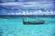 Little fishing boat in blue sea - 67954224
