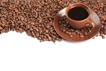 Coffee cup and beans on a white background