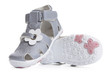 Gray shoes for kids isolated over a white background