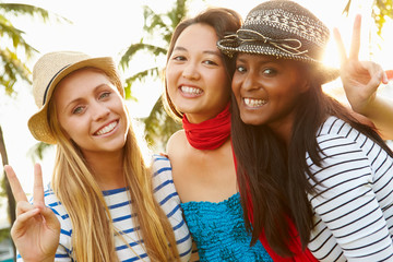 Group Of Female Friends Having Fun In Park Together