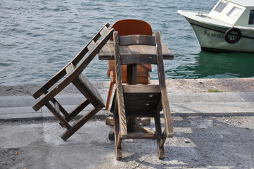 wooden furniture by the sea