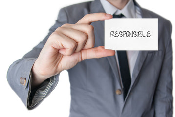 Responsible. Businessman holding business card