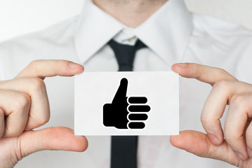 Thumbs up. Businessman holding business card