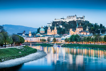 Salzburg skyline with river Salzach at dusk, Austria