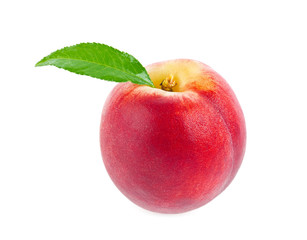 Ripe juicy peach with green leaf