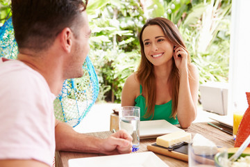Couple Enjoying Meal Outdoors At Home