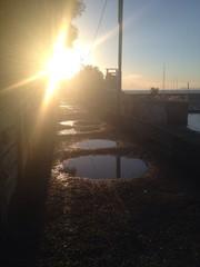 Reflejo del sol en charcos