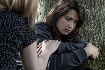 woman comforting her sad friend