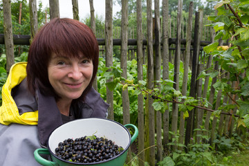 Middle aged woman with blackcurrant