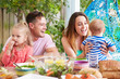 Obrazy na płótnie, fototapety, zdjęcia, fotoobrazy drukowane : Family Enjoying Outdoor Meal At Home