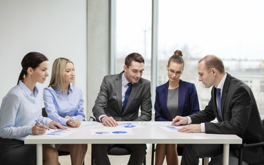 business team with documents having discussion