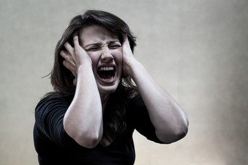 Angry young woman shouting