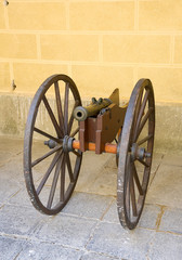 Ancient cannon on wheels. vertical photo.