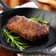 new york strip steak cooked in iron skillet