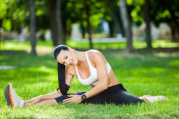 sport woman doing stretching fitness exercise in city park