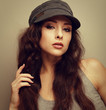 Vintage closeup portrait of sexy woman in hat looking flirting