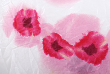 Silk floral crumpled fabric background with red poppies .