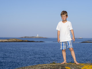 Boy at sea coast