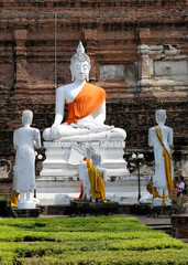 sitting white Buddha in the ancient temple