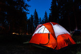 Campsite with illuminated tent