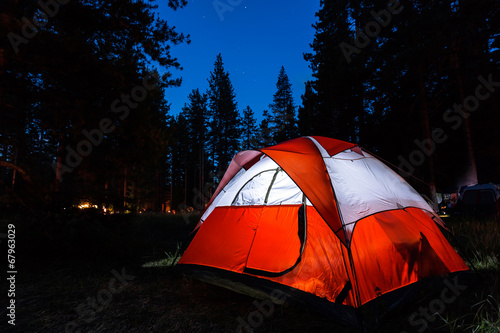 Fotobehang Kamperen Campsite with illuminated tent