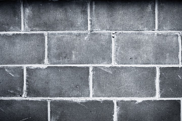 Closeup of bricks in dark wall