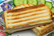 Toasted sandwich with ham and cheese, close up