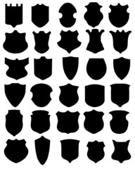 Black silhouettes of shields on a white background, vector