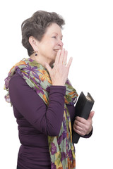 elderly woman with bible and a giggle
