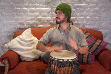 Young Male Playing Djembe Drum.