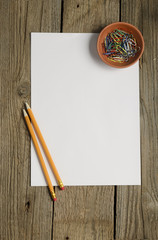 Blank paper, pencils and paper clips