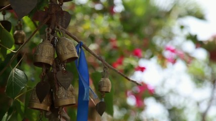 bells of wish on the tree near buddhist temple