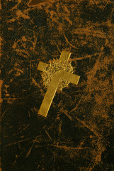 Antique gold cross on vintage aged leather.