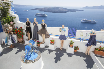 mannequins and sea liner on Santorini