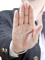 stop sign by one palm - businessman hand gesture