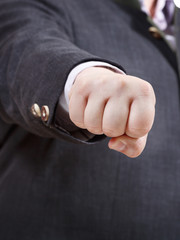 front view of clenched fist of businessman