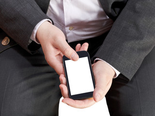 above view of mobile phone in businessman hand