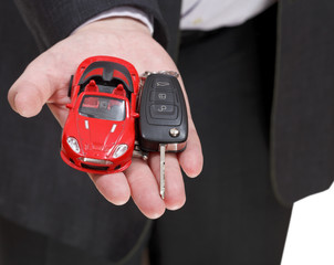 red car and key in salesman's hand