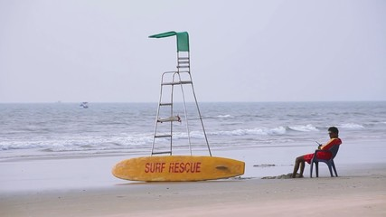Surf rescue on beach. Indian ocean. Lifesaver.