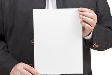man holds blank sheet of paper in hands