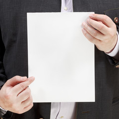 salesman holds blank sheet of paper in hands