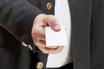 front view of business card in businessman hand