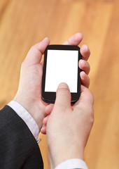 mobile phone cut out screen in businessman hands